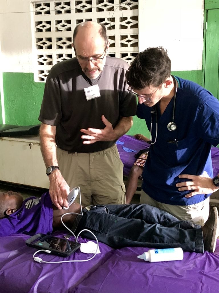 Doctor teaching ultrasound. Global Health Teams - Haiti Medical Volunteer